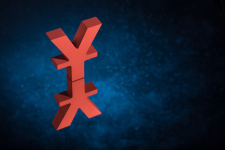 Red Japanese of Chinese Currency Symbol Yen or Yuan With Mirror Reflection on Blue Dusty Background