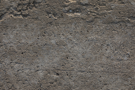 Close-up of Weathered Crumbly Cement Concrete Wall on Direct Sunlight 스톡 콘텐츠
