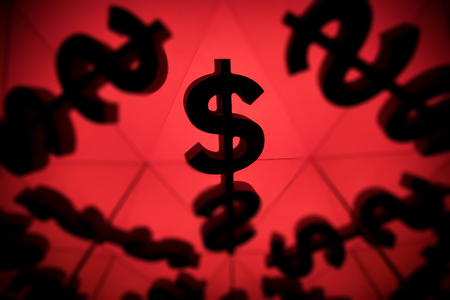 Dollar Currency Symbol With Many Mirroring Images of Itself on Red Background