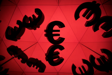 Euro Currency Symbol With Many Mirroring Images of Itself on Red Background