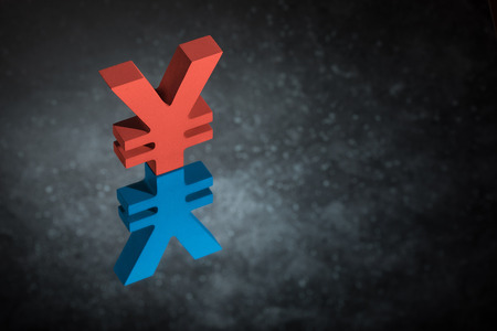 Red and Blue Japanese of Chinese Currency Symbol Yen or Yuan With Mirror Reflection on Dark Dusty Background