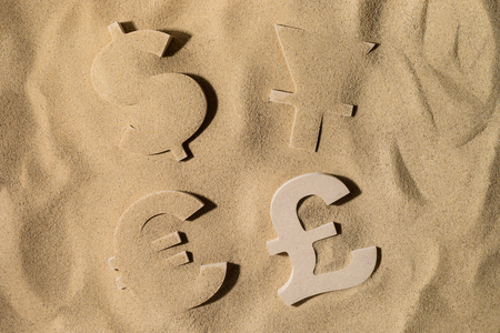 The World's Main Currency Symbols or Signs Covered with Sand in the Sun after Crisis but British Pound Stay on Top Reklamní fotografie