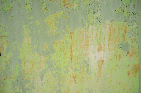 Detail of Old, Grunge, Rusty Metal Doors with Layers of Green, Turquoise and Yellow Paint and Rust Stock Photo