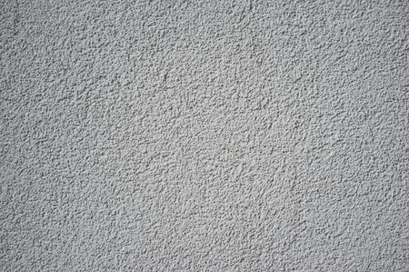 Monochromatic Grainy Texture of Plaster Wall on Bright Sun 版權商用圖片