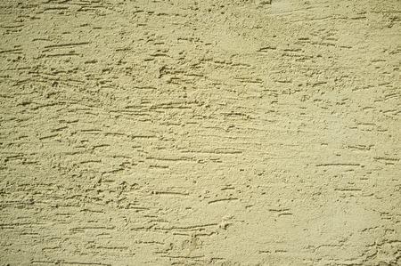 Monochromatic Grainy Texture of Yellow Plaster Wall on Bright Sun