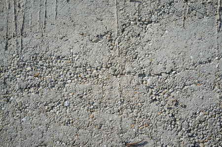 Crumbly Roughly Done Weathered Grey Concrete Wall with Pebbles Texture Detail Reklamní fotografie