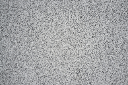 Monochromatic Grainy Texture of Plaster Wall on Bright Sun Reklamní fotografie