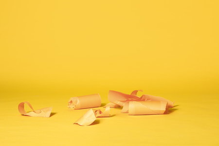 Various Stripes of Yellow Paper Left on Vibrant Yellow Seamless Background