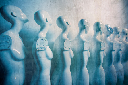 Plastic Woman Mannequins Standing in The Line, With One Looking to Another Direction then the Others