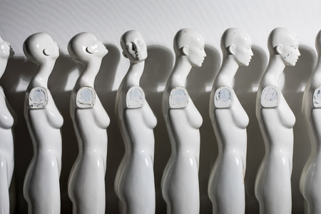 Plastic Woman Mannequins Standing in The Line, With One Looking to Another Direction then the Others all in sad Depressive Mood.
