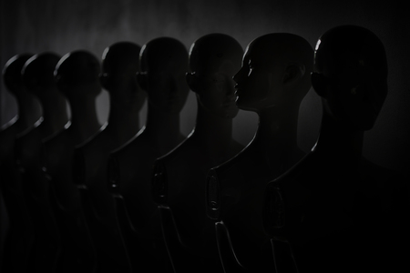 Dark Depressive Picture of Plastic Woman Mannequins Standing in The Line, With One Looking to Another Direction then the Others Imagens - 124979499