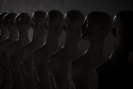 Plastic Woman Mannequins Standing in The Line, With One Looking to Another Direction then the Others in Dark and Sad Atmosphere. Reklamní fotografie
