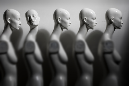 White Woman Torso Mannequins Standing in The Line All Looking to Same Direction except of One, Image Reminds of Robotization and Industrialization Reklamní fotografie
