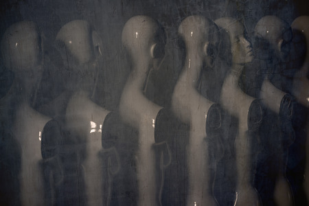 White Woman Torso Figurines Standing in The Line All Looking to Same Direction except of One with Artistic Misty Mood