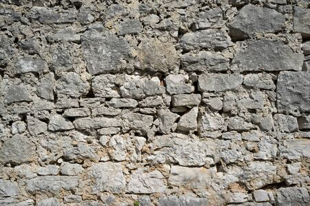 Old Grungy and Weathered Stone Wall Pattern Background