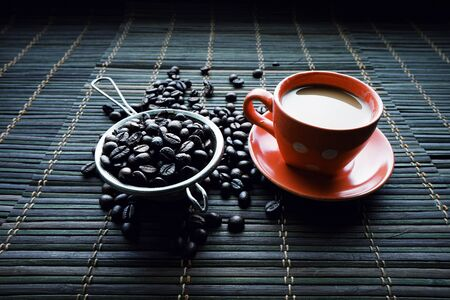 cup of coffe with coffe bean