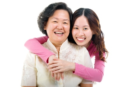 offspring: cheerful asian senior woman and daughter  Stock Photo
