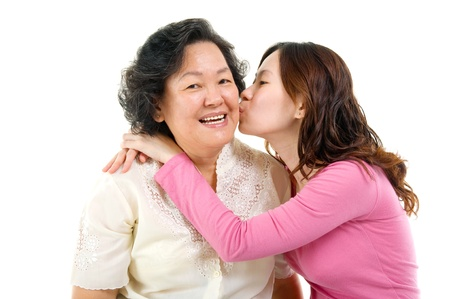 Asian daughter kiss her mother Stock Photo - 19381644