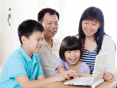 Asian family using laptop photo