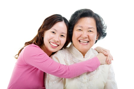 Cheerful asian senior woman and daughter photo