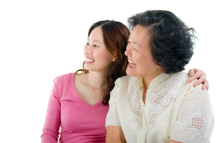 Asian senior woman and daughter looking to the side