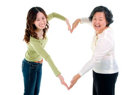 Asian senior woman and daughter making the sign of love, isolated on white background  photo