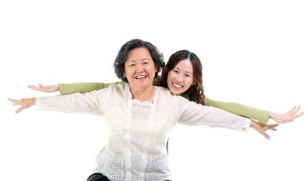 Asian senior woman and daughter  photo