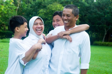southeast asian: Muslim family outdoor Stock Photo