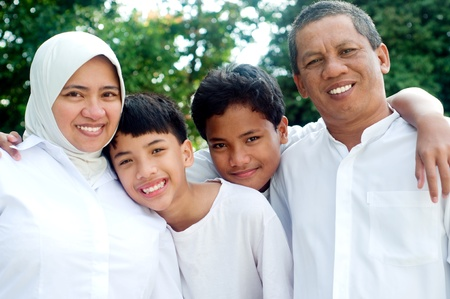 malay: Outdoor portrait of muslim family