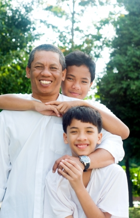 Southeast asian father and sons photo