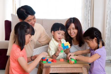 adults learning: Asian family playing wife building blocks