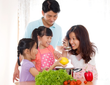 Asian family cooking  photo