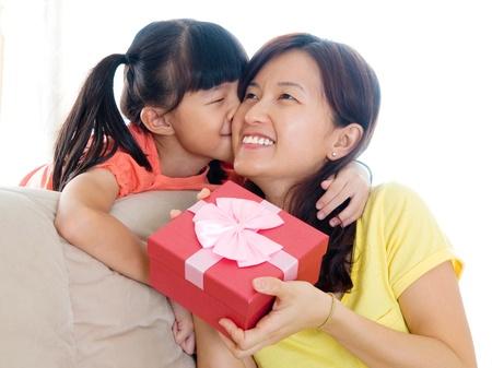 Little asian kiss her mother photo