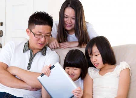asian family home: Asian family using tablet computer