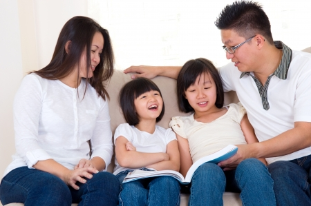 Asian family reading at home photo
