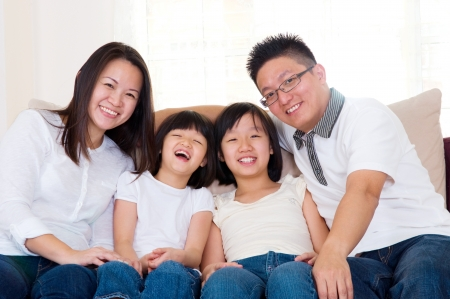 Asian family relaxed at home photo