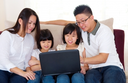 Asian family using laptop photo