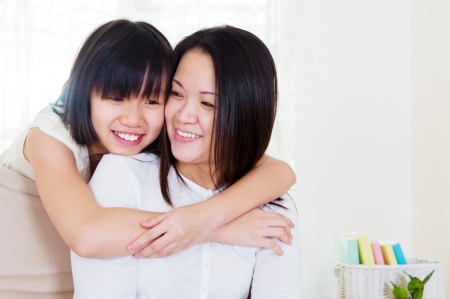 healthy asian family: daughter hugging mother