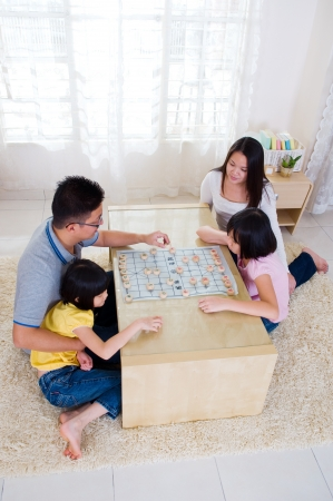 Asian family playing chinese chess Stock Photo