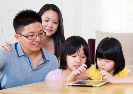 Asian family using tablet computer photo