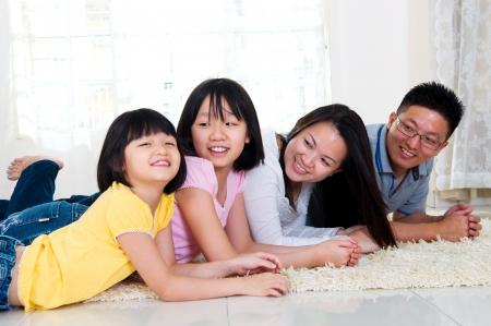 Asian family lying on the floor