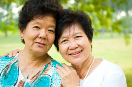 smile close up: Outdoor portrait of cheerful asian women Stock Photo