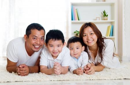 asian wife: beautiful asian family lying on the floor Stock Photo