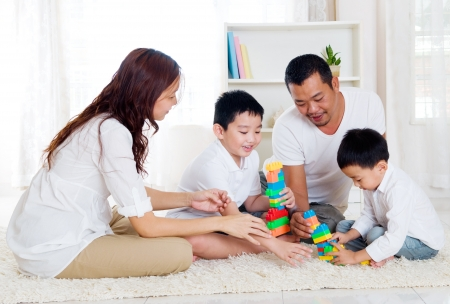 Asian family playing building blocks