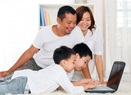 asian preschool children using laptop photo