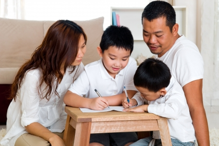kids writing: Asian kids writing