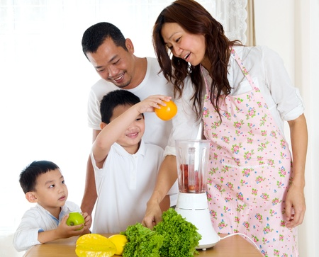 Asian boy helping mother in the kitchen photo