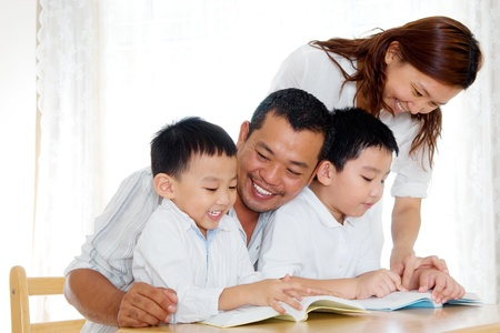 indonesian: Asian family reading at home Stock Photo