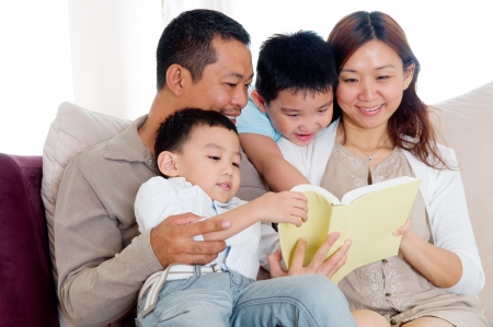 Asian family reading Stock Photo - 19912446