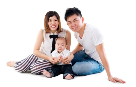 Asian family sitting on the floor photo